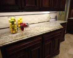 dark cabinets light floors and back splash