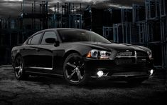 2013 Dodge Charger. This is what I want. All blacked out with black interior and black suede down the seats...so pretty!