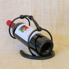 Snaffle Bit Wine Bottle Holder by Bar 18 Creations. Made from an authentic snaffle bit and horseshoe. Handcrafted in the U.S.A.