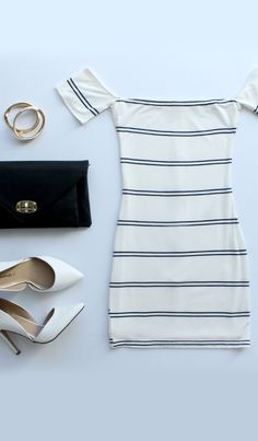 Paper Trail Navy Blue and Ivory Off-The-Shoulder-Dress with a blue blazer
