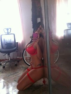 hot brunette with huge tits selfshot in red lingerie Original Article