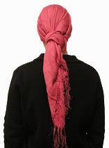 The Ponytail Fold your scarf in half so that it forms a triangle: Place scarf over your head so corner is in the back creating a tail and 2 longer corners are hanging over the side.Tie left and right corner at base of neck.  Pull right and left corners tight so scarf won't slip.Take corners hanging over your shoulder and gently wrap around tail. Once both have been tied you should be left with a long ponytail and two loose ends tie the ends.
