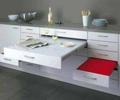 This pull-out dining design, by Alno, may look like a lightweight worktop extender, but features sturdy seats that can cope with loads up to...