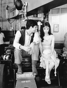 Sharing a seat on a camera boon with actor Anthony Perkins on the set of Green Mansions.