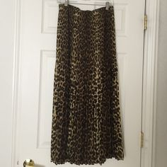 "Allison Taylor Leopard Print Maxi Skirt Allison Taylor Leopard Print Maxi Skirt pleated elastic waist. Size M but it fits like Size L. Measurements: 14.5"" Waist.  21"" Hips. 37"" Length. Gently used and excellent condition. No trade, no holding, no off sight payment Allison Taylor Skirts Maxi"