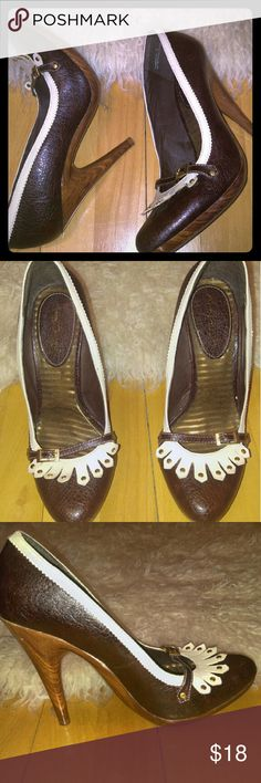 Unique, quirky Brown pumps Size 9 These shoes are in excellent shape; rarely worn; wooden look heel with smooth shiny finish. Anne Michelle Shoes Heels