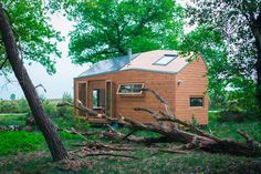 This contemporary off-grid tiny house is home to Marjolein Jonker in the Netherlands. She travels the country raising awareness about tiny living.