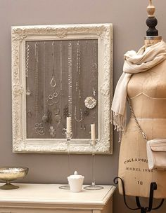 Jewellery hung in a picture frame.