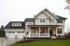 Very close: Corbels, trim color, house color, shake, black metal porch roof, composite roof, rail, black door with side lights, windows
