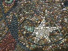 Miro inspired pebble mosaic by Jeffrey Bale. Detail of mosaic 'Cyphers and Constellations in Love with a Woman'. jeffreygardens.blogspot.com