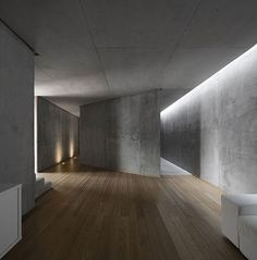 Concrete envelops the building, like weathered skin tanned by Portugal's climate