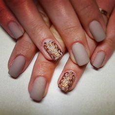 Love the nude matte nails. Probably won't be able to recreate the swirls but I'll still incorporate gold some how.