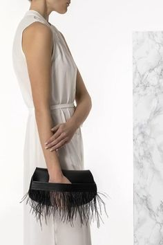 Bring a glamorous edge to your evening look with the Domna design clutch. Handmade of fine quality calf leather and silky feathers, this unique evening bag comes in 3 colors, black, camel/brown (waxed tan) and nude/pink (nubuck). The nude one can be ideal small bag for bride. Greek Chic Handmades Women's bags are handcrafted in Athens, Greece from the same premium leather we built the sandals with and the impeccable local craftsmanship. Shop your favorite leather bag to accompany your… Handmade Clutch, Leather Bags Handmade, Handmade Bags, Black Clutch Bags, Leather Clutch Bags, Bridal Sandals, Lace Up Sandals, White Leather, Calf Leather