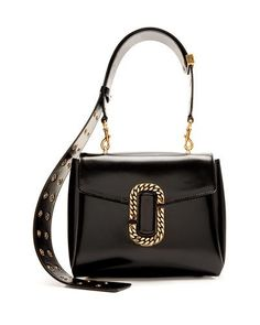 9e10f9b5abc9f0 Marc Jacobs polished leather satchel bag. Golden hardware. Removable,  adjustable top handle.