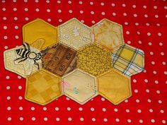 Bee Quilt - great use for the hexagon. I see using yellow hexies and making a bee hive.