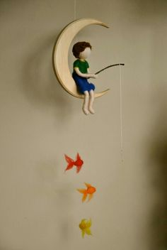 Boys Mobile Waldorf inspired needle felted : The fishing boy in the moon with three fishes. (via Boys Mobile Waldorf inspired needle felted The by MagicWool) Waldorf Crafts, Waldorf Dolls, Felt Crafts, Diy And Crafts, Arts And Crafts, Boy Mobile, Needle Felting, Kids Room, Diy Projects