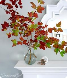 autumn: huge branches with leaves in a vase