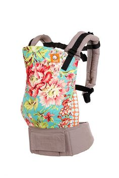 Perfectly balanced between a feminine beauty and a lively style, Bliss Bouquet is an instant classic. Bliss Bouquet dislays richly detailed flowers against a sky colored backdrop and accented with fun polka dot padding and light gray canvas. Bliss Bouquet adds subtle beauty to your daily cuddle adventures. Baby Tula's 'Bliss Bouquet' baby carrier can be used in both front carry and back carry, and allows for babywearing from infants to toddlers.