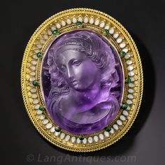 Suffragette Victorian Amethyst Cameo Brooch.  Renaisance style inspired the beautiful green and white enamel cloisonne border surrounding this high relief classical female hand carved in amethyst. This brooch dates to the 1880's and based on the colors and the description below, from Antique Jewelry University, we feel confident in calling it a Suffragette Jewel...