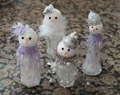 more salt shaker snowmen ~ I love these with the lavender and pearls! Different from most!
