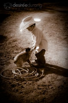 Cute little cowboy and his trusty dog!