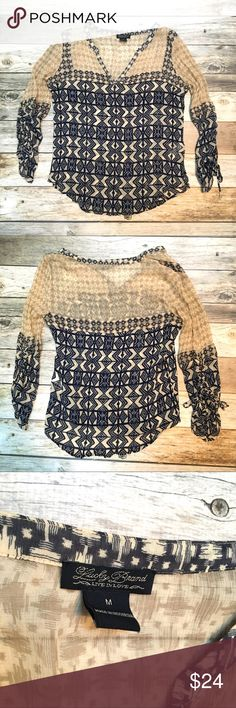 Lucky Brand Boho Sheer Blouse Size Medium Lucky Brand Boho Sheer Blouse Navy and Cream Size Medium Ruched Long Sleeves with ties. Lucky Brand Tops Blouses