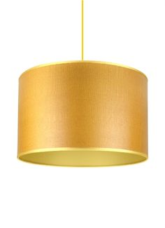 Golden sand wood veneer drum shade with gold lining and trim.