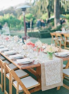 Get inspired: A lace and burlap table runner adds a touch of rustic romance to that outdoor wedding reception!