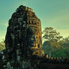 Cambodia - by Bayon. One of the 49 towers in the Bayon temple at sunrise in Angkor Thom, Cambodia. Each of these towers symbolize king Jayavarman VII (1181-1219) in the form of the Boddhisatva Avalokiteshvara.