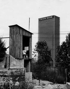 A Bunker Hill outhouse with the Union Bank tower in the background, downtown Los Angeles, 1967.