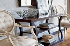 Ethan Allen entryway. Our Modern Glamour shaped led console and Francesca carved chairs.