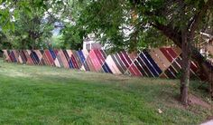 """""""Hannah's Highland Lawn Plat, 1884."""" A 345 foot long chain link fence weaving surrounding the historic Hannah Barker House, 800 Arapahoe, in downtown Boulder, CO. Woven by Denise Perreault with 116 reclaimed tape measures, and thousands of yards of surplus fabric donated by Hunter Douglas. Believed to be the largest chain link fence weaving in the country. Chain Link Fence Privacy, Chain Fence, Fence Weaving, Shed With Porch, Legacy Projects, Sensory Garden, Fence Art, Farm Gardens, Community Art"""