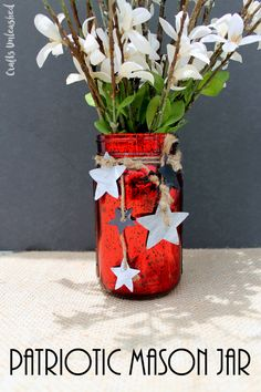 Add this fun patriotic DIY mason jar craft to your summer decor. Perfect for your 4th of July parties, a table centerpiece, and so much more!