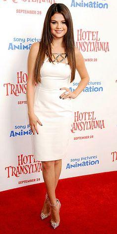 Selena Gomez in metallic-accented fitted white dress at LA premiere of 'Hotel Transylvania'