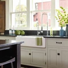 To keep your countertops from turning into a catch-all for the post-party dishes and glassware, use afarmhouseor trough sink, like the oneshown here, into your kitchen design. Unlike a traditional two-sided sink, trough sinks are larger and usually much deeper, making them roomy enough to hold oversized platters, baking dishes, and dinnerware all at once, so you can keep the inevitable mess contained until you're ready to get your hands dirty.