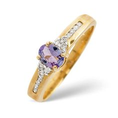 Diamond Essentials 0.32 Ct Tanzanite and 0.1 Ct Diamond Ring In 9 Carat Yellow Gold From the Diamond Essentials collection in 9 Carat Yellow Gold. Ladies. Presented in a Contemporary hardwood gift box. Our price: pound