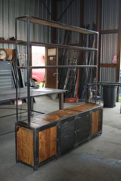 Steel frame mixed with barn wood and expanded sheet metal.