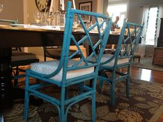 love the turquoise bamboo dining room chairs!