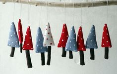 Holiday ornaments. A set of 3 Christmas trees. Blue red by adatine