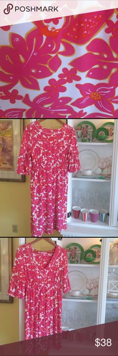 Lilly Pulitzer Dress Bright pink pattern with little orange geckos hidden throughout. It is a size Small, deep V-Neck, 93% Viscose, 7% Spandex. Elastic accent around sleeve and empire waist.  Would make a perfect cover up! Lilly Pulitzer Dresses