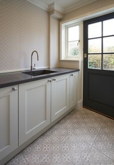 grey flooring Stylish utility room space with black worktops and Laura Ashley Mr Jones dove grey floor tiles Laura Ashley Mr Jones Tiles, Laura Ashley Floor Tiles, Laura Ashley Kitchen, Laura Ashley Dove Grey, Laura Ashley Home, Tiled Hallway, Hallway Flooring, Grey Flooring, Kitchen Flooring