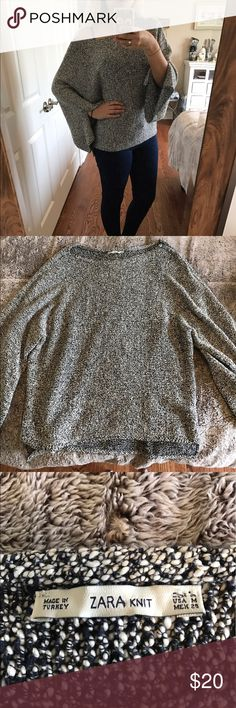 Zara slouchy sweater Beautiful black and white slouchy sweater. Sleeves are big and have small slits up them. Never worn. Zara Sweaters