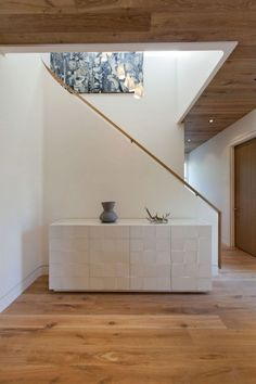Minimalist Modern House Architecture Design : Wonderful White Cabinet Wood Flooring Nice Entryway To The Upper Level For Ideas And Inspirations
