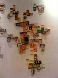 Matchbox wall art at Anthropologie  something so simple, so creative,  do they even make matchboxes anymore? hmmm