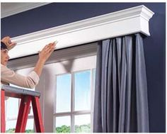 For wall behind bed- to offset uneven windows