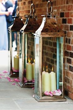 Simple venue decorations - storm lanterns filled with petals and candles. Try Cerise Large Roses - http://www.confettidirect.co.uk/large_natural_roses.html