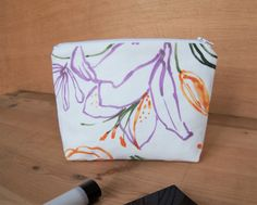Accessory for a woman or girl  White cotton fabric makeup case Small summer beach bag with tropical purple orange flowers Zipped pouch Best