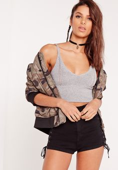 Channel some major boho vibes this season in this strappy bralet. Bralets are ultra feminine, chic and perfect for sunshine vibes. In a pointelle fabric, cami straps, bralet style and grey hue, you'll be looking playfully dreamy. Team with ...