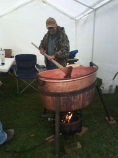 Making apple butter in copper pots at the Apple Butter Festival.