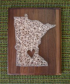 Cute DIY string art idea!  Choose your state (or anything else that comes to mind) and create your own shape to embelish!--- Minnesota String Art by Speckless